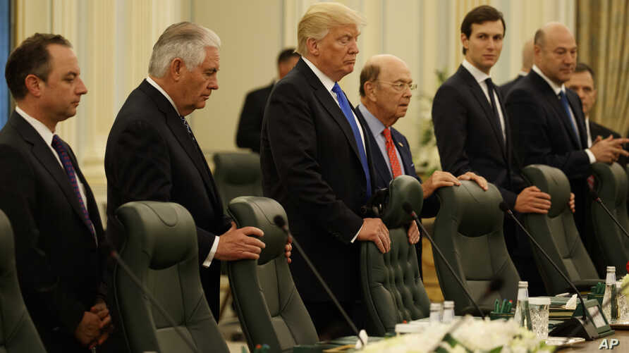 President Donald Trump waits for the beginning of a bilateral meeting with Saudi King Salam at the Royal Court Palace, Saturday, May 20, 2017, in Riyadh. From left are, White House chief of staff Reince Priebus, Secretary of State Rex Tillerson, Trum