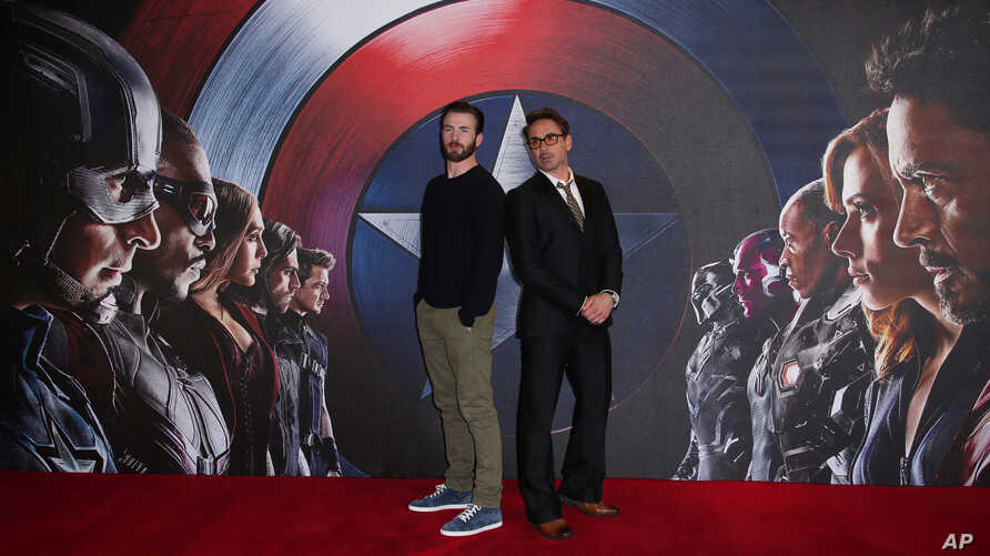 """Chris Evans, left, and Robert Downey Jr. pose for photographers at the photo call of the film """"Captain America Civil War"""" in London, April 25, 2016."""