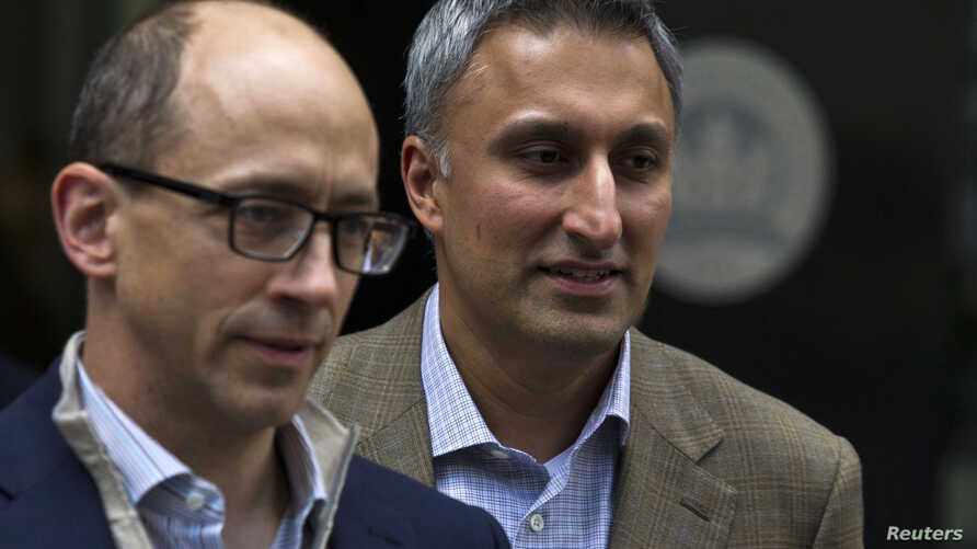 Dick Costolo (L), chief executive of Twitter, and the company's chief financial officer Mike Gupta leave JP Morgan headquarters after a meeting before the firm's IPO in New York, Oct. 25, 2013.