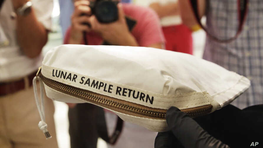 The Apollo 11 Contingency Lunar Sample Return Bag used by astronaut Neil Armstrong, to be offered at auction, is displayed at Sotheby's in New York, July 13, 2017.