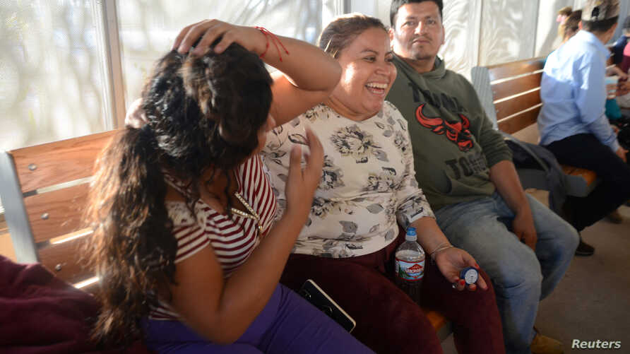 Central American migrants are pictured as they wait to enter the U.S., asking for refuge and to be reunited with their children, after being separated from them by immigration authorities when crossing into the United States illegally last year, Mexi