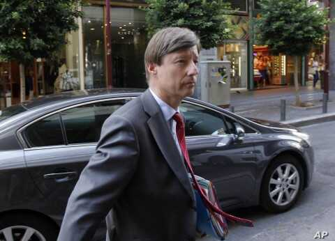 European Commission official Matthias Mors arrives at the Greek Development Ministry in Athens, August 30, 2011