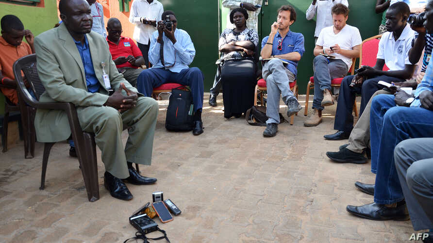 Oliver Modi, left, chair of the Union of Journalists of South Sudan, attends a meeting in Juba on the killing of South Sudanese journalist Peter Moi of The New Nation newspaper, Aug. 21, 2015. Days before the fatal shooting, President Salva Kiir publ