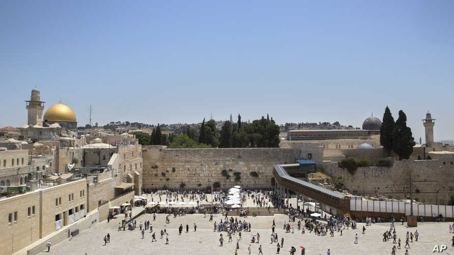 Visitors are seen at the Western Wall, the holiest site where Jews can pray in Jerusalem's Old City, June 26, 2017.