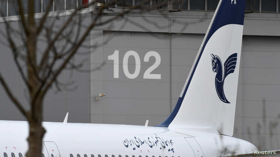 """An Airbus A321 with the description """"The Airline of the Islamic Republic of Iran"""" below the tail fin is parked at the Airbus facility in Hamburg Finkenwerder, Germany, Dec. 19, 2016."""
