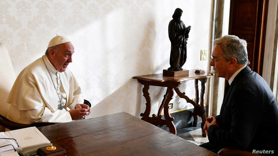 FILE - Pope Francis (L) meets former Colombia's President Alvaro Uribe (R) at the Vatican, Dec. 16, 2016.