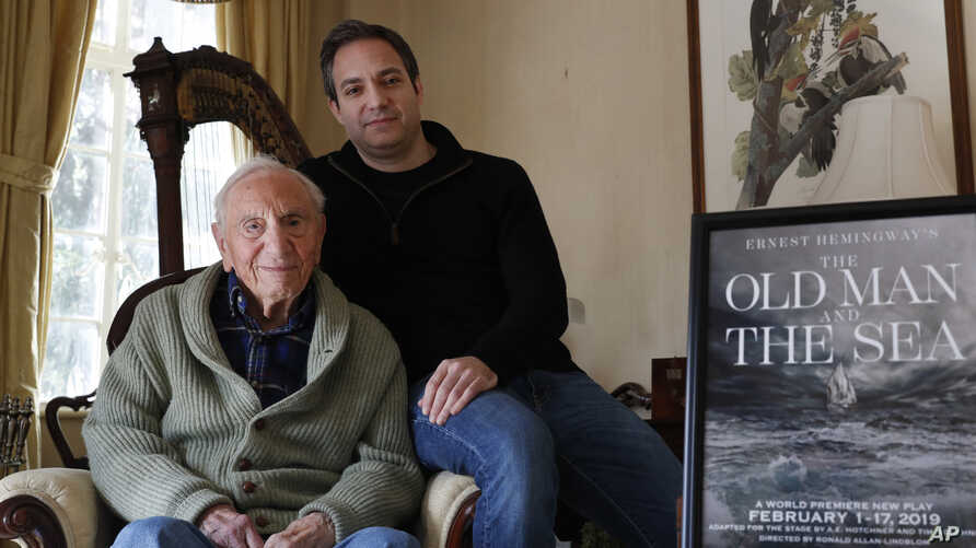 Ernest Hemingway's close friend and biographer A.E. Hotchner, left, poses for a photograph with his son Tim Hotchner, Tuesday, Jan. 22, 2019, in the Hotchner family home in Westport, Conn.