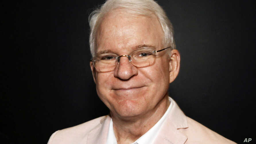 "FILE - Steve Martin poses during ""The Un-Private Collection: Eric Fischl and Steve Martin,"" an art talk presented by The Broad museum in Santa Monica, Califorina, June 23, 2014."