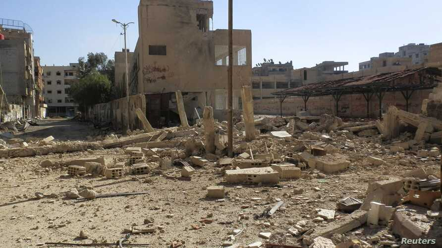 A view of rubble and damaged buildings after what activists said was shelling by forces loyal to Syria's President Bashar al-Assad in Daraya February 4, 2013, in this picture provided by Shaam News Network.