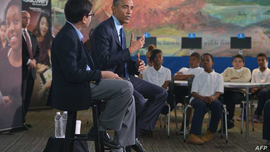 """U.S. President Barack Obama speaks during a live """"virtual field trip"""" with students from around the country at the Anacostia Library, April 30, 2015, in Washington, D.C."""