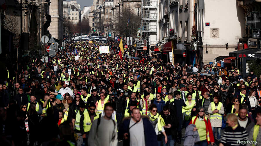 """Protesters take part in a demonstration of the """"yellow vest"""" movement in Paris, Feb. 16, 2019."""