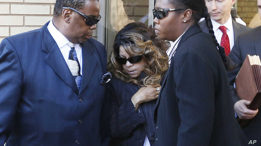 Tyka Nelson (c) the sister of Prince, leaves the Carver County Courthouse in Chaska, Minn., where a judge confirmed the appointment of a special administrator to oversee the settlement of the entertainer's estate. Nelson is Prince's only full sibling