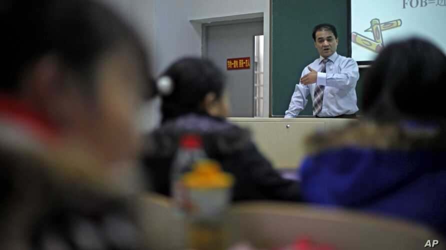 In this Tuesday, Dec. 1, 2009 photo, economist Ilham Tohti speaks to students at the Central Nationalities University in Beijing, China. His weekly lectures are a kind of high-wire act and he has been put under house arrest dozens of times over the p