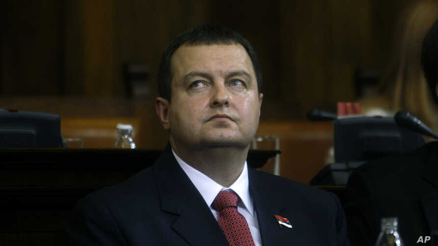 Serbia's prime minister designate, Ivica Dacic, front, looks on during a parliamentary session in Belgrade, Serbia, July 26, 2012.