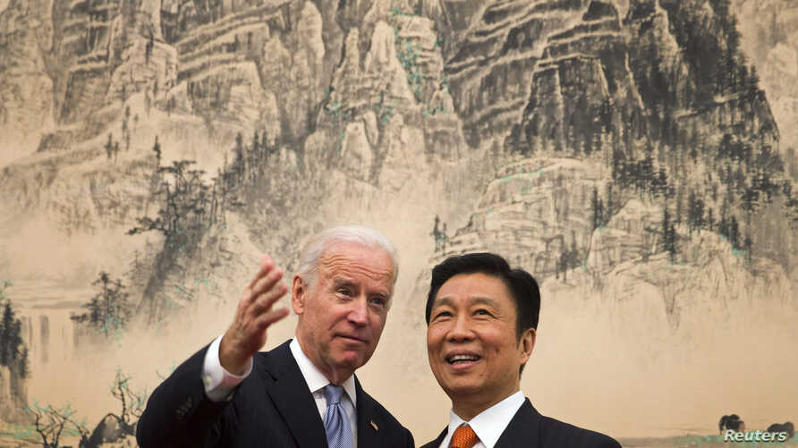 U.S. Vice President Joe Biden (L) chats with Chinese Vice Premier Li Yuanchao before their luncheon at the Diaoyutai State Guesthouse in Beijing, Dec. 5, 2013.