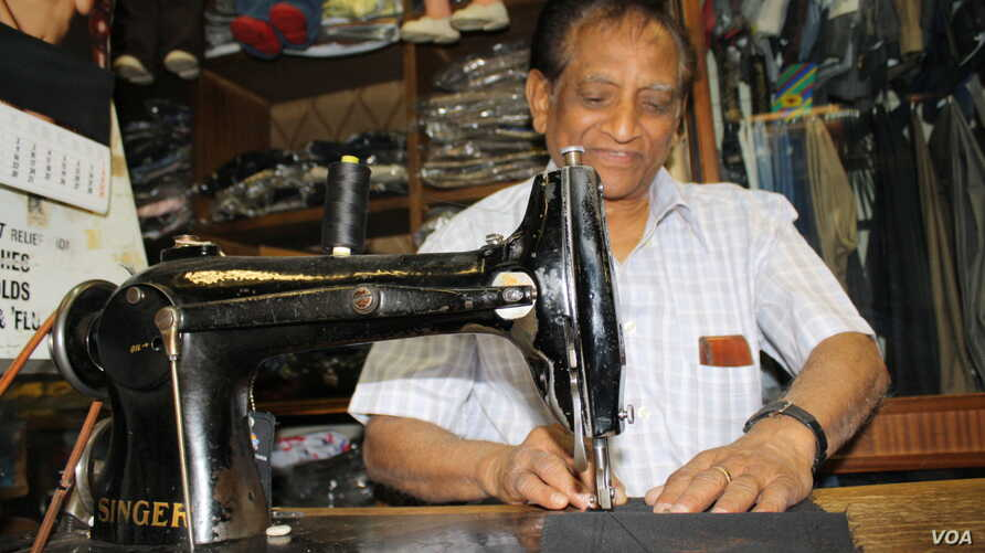 Chiman Chhiba carries on a family tailoring business founded by his father a century ago in central Johannesburg. Photo by Darren Taylor