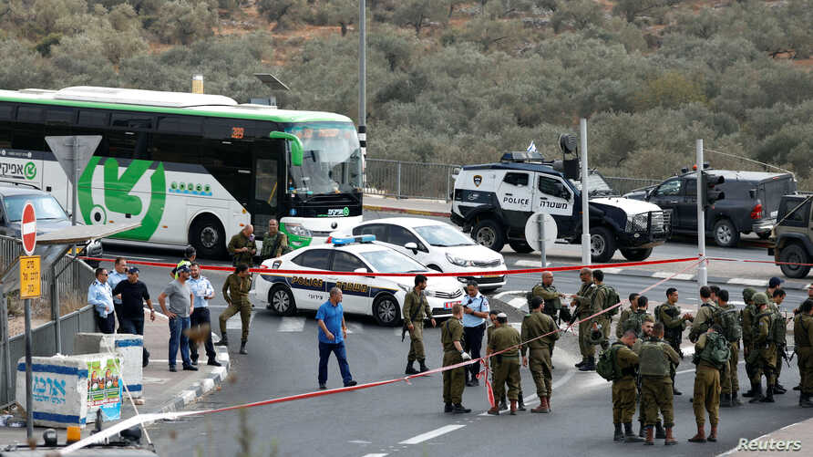 FILE - Israeli forces gather at the scene of an attempted stabbing near the Jewish settlement of Ariel in the occupied West Bank, Oct. 15, 2018.