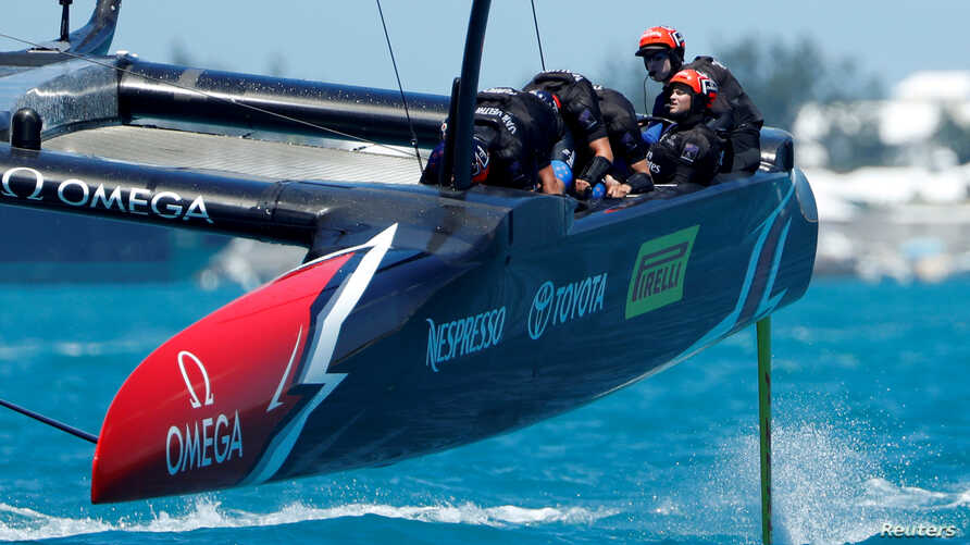 FILE - Helmsman Peter Burling drives Emirates Team New Zealand to a win over Oracle Team USA in America's Cup finals, June 25, 2017.