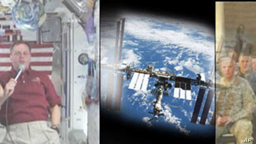 US forces in Iraq speak with 2 NASA astronauts aboard the ISS in a video downlink aired on NASA TV about life on the station, their military careers and what it is like to live in space for up to 6 months, 29 Dec 2009