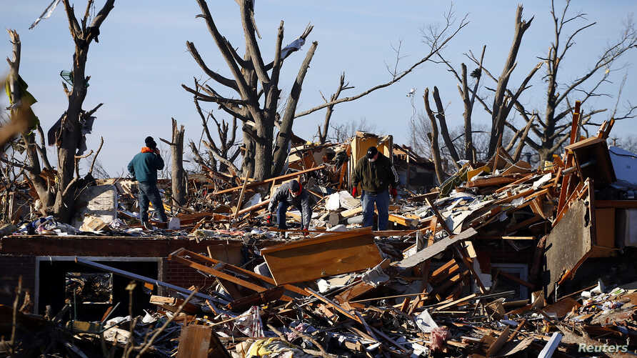 Residents sort through the rubble after their home was destroyed during a tornado in Washington, Illinois, Nov. 19, 2013.