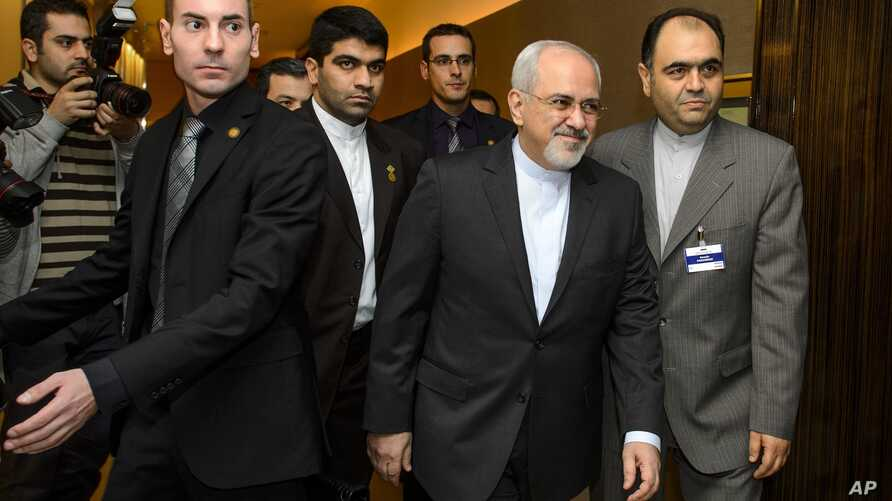 Iranian Foreign Minister Mohammad Javad Zarif, second right, arrives  for  talks over Iran's nuclear program in Geneva, Nov. 22, 2013.
