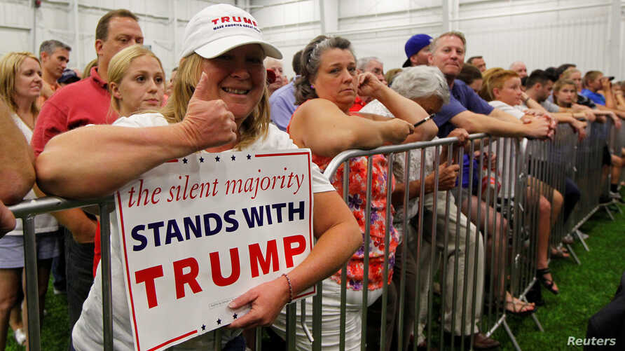 Campaign supporters listen to Republican U.S. presidential candidate Donald Trump address during a campaign stop at the Grand Park Events Center in Westfield, Indiana, July 12, 2016.