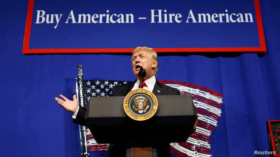 President Donald Trump speaks before signing an executive order directing federal agencies to recommend changes to a temporary visa program used to bring foreign workers to the U.S. to fill high-skilled jobs during a visit to Snap-On Inc, a tool manu
