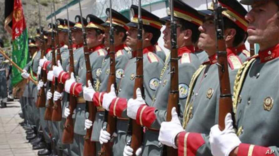 Afghan guards of honor stand in line after raising  Afghanistan's flag during the transfer of authority in Bazarak, Panjshir province north of Kabul, Afghanistan, July 24, 2011