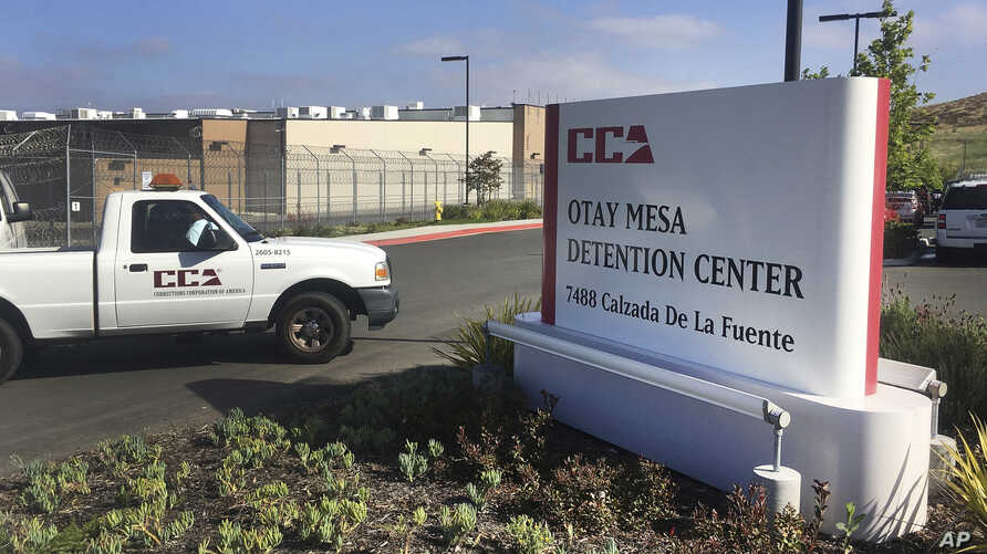 FILE - A vehicle drives into the Otay Mesa detention center in San Diego, California, June 9, 2017. The American Civil Liberties Union is suing the U.S. government over what it calls the unlawful separation of a Congolese woman and her 7-year-old dau