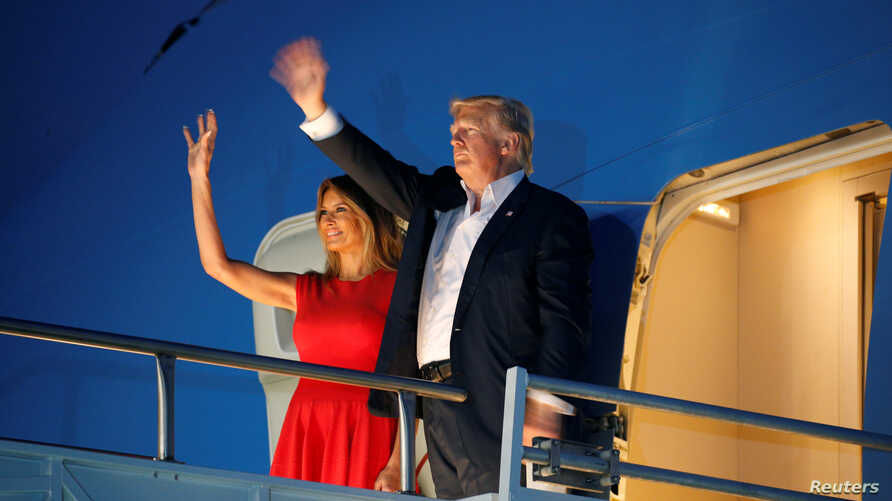 "U.S. President Donald Trump and first lady Melania Trump wave from Air Force One after a ""Make America Great Again"" rally at Orlando Melbourne International Airport in Melbourne, Florida, Feb. 18, 2017."