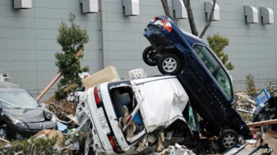 This March 14, 2011 photo shows cars upended and destroyed by the tsunami that struck Sendai port in Miyagi Prefecture, Japan, on March 11.