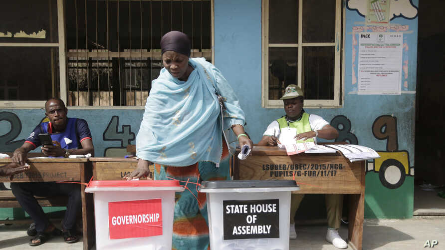 A woman casts her votes during the gubernatorial and state house assembly elections at a polling center in Makoko near Lagos, Nigeria, March. 9, 2019.