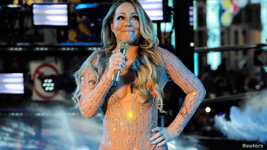 Mariah Carey performs during a concert in Times Square on New Year's Eve in New York,  Dec.  31, 2016.