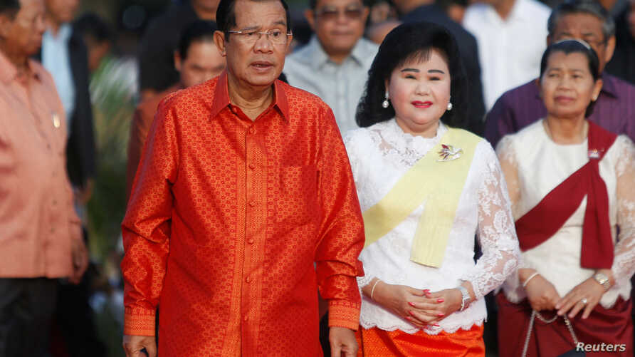 Cambodia's Prime Minister Hun Sen and his wife Bun Rany hold a ceremony at the Angkor Wat temple to pray for peace and stability in Cambodia, in Siem Reap province, Cambodia, Dec. 3, 2017.
