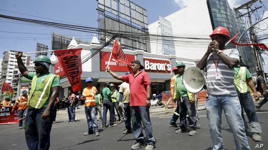 FILE - Union workers protest corruption outside the Public Ministry in Panama City, Feb. 10, 2017. Panama's Attorney General's Office ordered a search of offices belonging to law firm Ramon Fonseca Mora, a partner at Mossack-Fonseca, accusing the fir