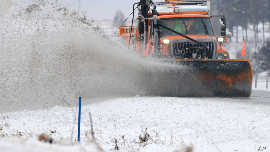 A snowplow clears snow off of Interstate 80 near  Earlham, Iowa, Tuesday, Feb. 2, 2016. A winter storm that dumped heavy snow on Denver and much of Colorado has moved east into Nebraska and Iowa.