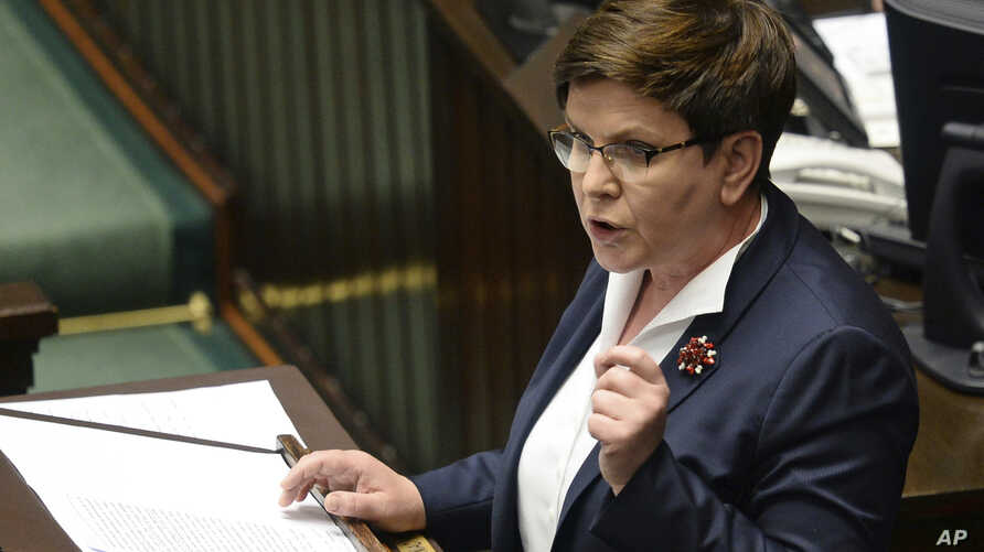 Polish Prime Minister Beata Szydlo speaks in the Polish parliament during a debate on a vote to dismiss Defense Minister Antoni Macierewicz, in Warsaw, May 24, 2017.