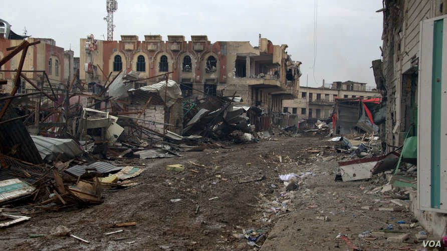 Many Mosul neighborhoods are left decimated by the war, but some residents remain in their homes because either they cannot travel or they fear greater suffering in the camps surrounding the Iraqi city, March 29, 2017.  (H. Murdock/VOA)