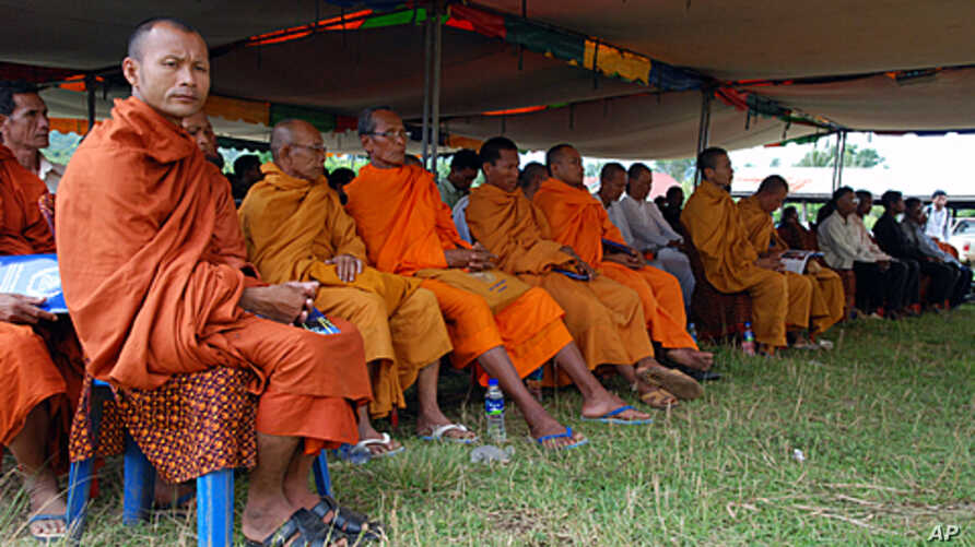 Monks attend the Khmer Rouge tribunal outreach in Samlaut district, western Cambodia on Friday 26, August 2011.
