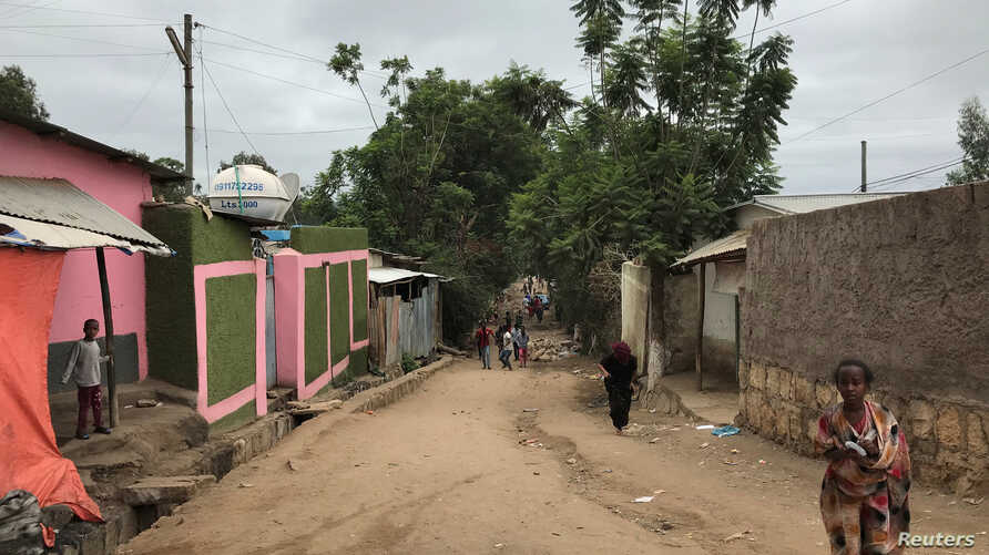 Residents walk in a neighborhood where ethnic Oromos live in Harar, Ethiopia, July 22, 2018.