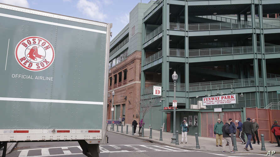 The tail end of the Red Sox team equipment truck crosses Yawkey Way outside Fenway Park, Feb. 5, 2018, in Boston. The truck was headed to  the team's spring training facility in Fort Myers, Florida.