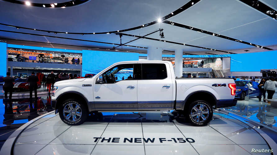 "FILE - A 2018 Ford F-150 ""King Ranch"" pickup truck is displayed during the North American International Auto Show in Detroit, Michigan, Jan. 10, 2017."
