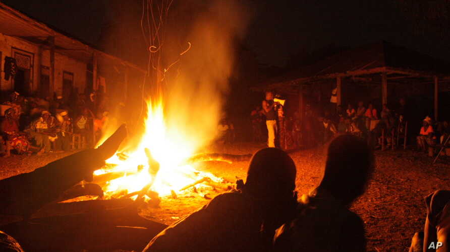 """In the remote village of Dugba-yeima, hundreds of people gather around a bonfire for """"fambul tok"""" a special reconciliation ceremony where victims and offenders alike speak openly about the atrocities committed in their community during eleven years o"""