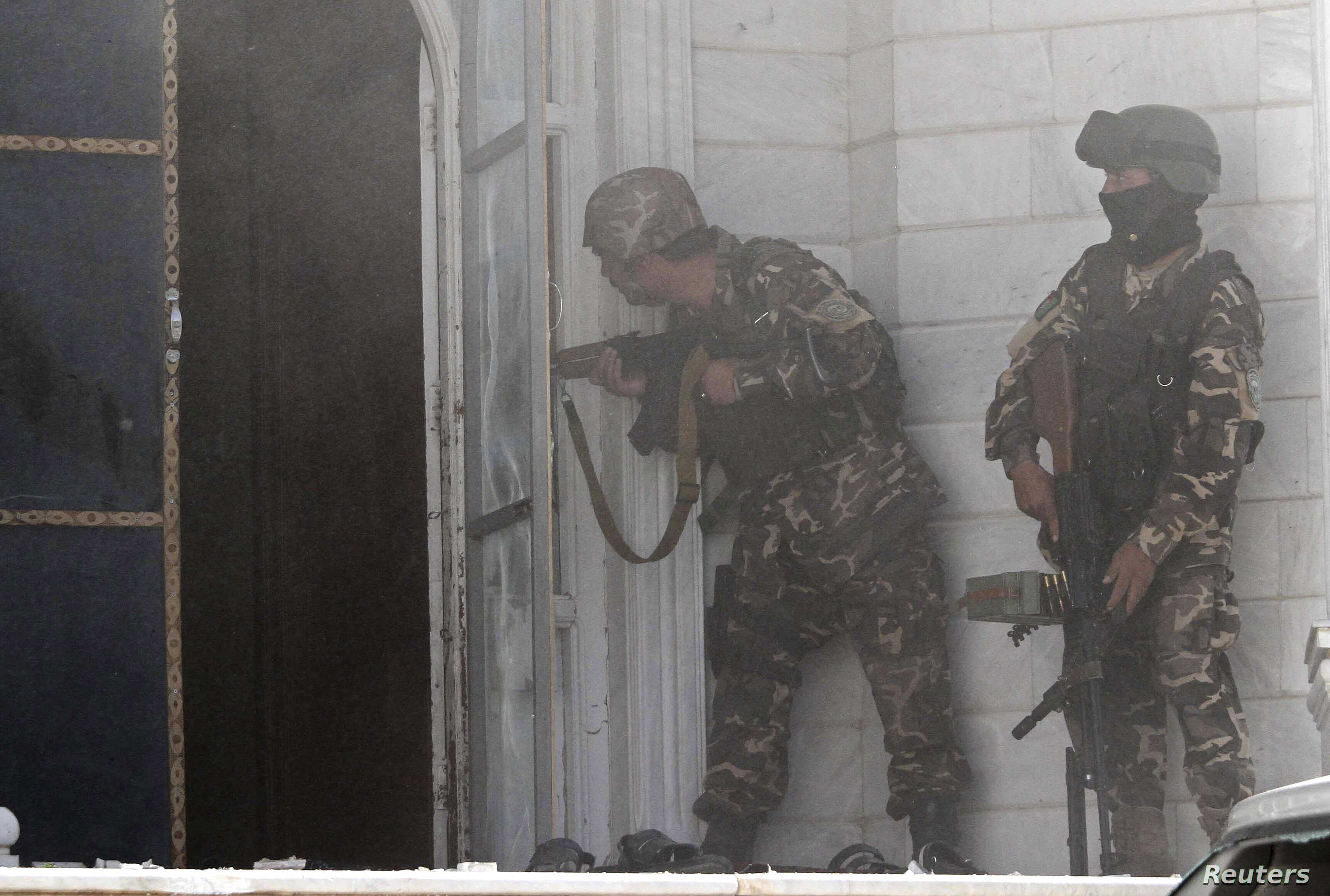Afghan security forces take position at the scene of an attack on the Indian consulate in Herat province, May 23, 2014.