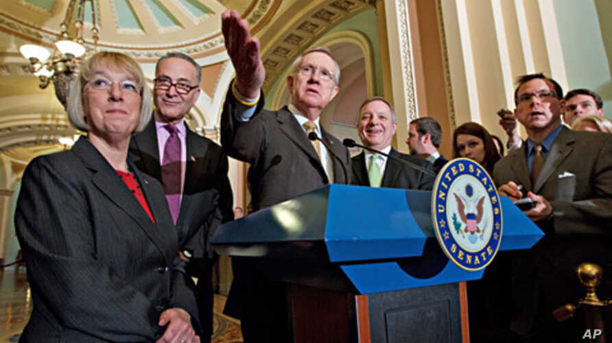 Senate Majority Leader Harry Reid, center, leads Senate Democrats' news conference on Capitol Hill, March 1, 2012.