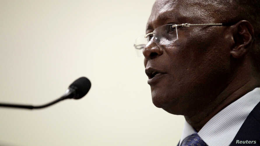 Interim President Jocelerme Privert speaks during his speech at the submission act of the report of a commission set up to re-examine the first round election results at the National Palace in Port-au-Prince, Haiti, May 30, 2016.