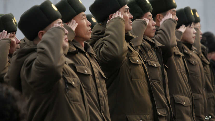 FILE - North Korean soldiers salute before the statues of North Korea's late leader Kim Jong Il, and his father, North Korea's founder Kim Il Sung, in Pyongyang, North Korea, Feb. 16, 2014.