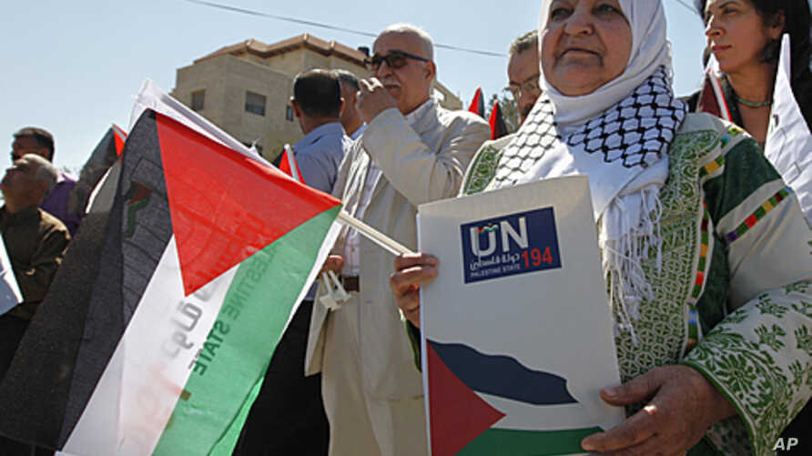 Palestinian activist Latifa Abu Hmeid holds a letter addressed to the UN Secretary-General Ban Ki-moon in front of the UN headquarters in the West Bank city of Ramallah, September 8, 2011.