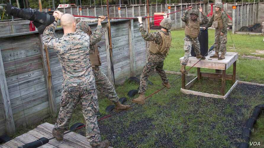 U.S. Marines from Marine Wing Support Detachment (MWSD) 31, climb across a rope during the Leadership Reaction Course on Marine Corps Recruit Depot Parris Island, South Carolina, Aug. 12, 2017.
