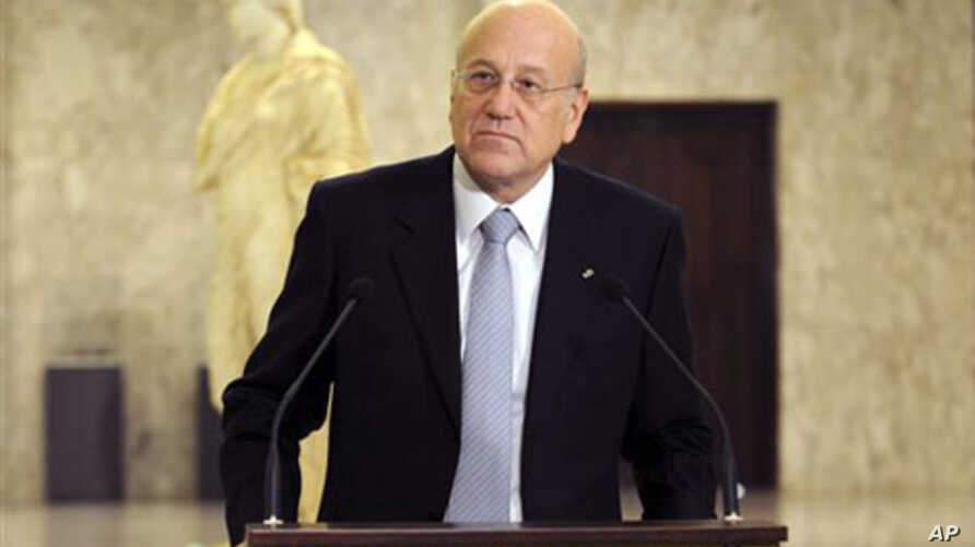 Lebanese Prime Minister-designate Najib Mikati speaks during a press conference at the presidential palace in Baabda, east of Beirut, 25 Jan 2011